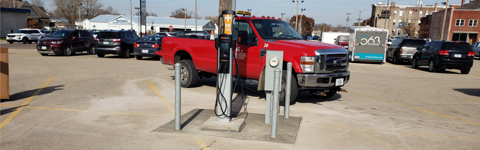 electric vehicle charger in public parking lot